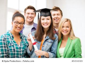 girl in graduation cap with certificate