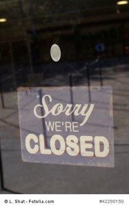 sign. sorry we're closed sign. sign on a glass door
