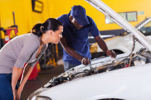 young woman sending her car for repair